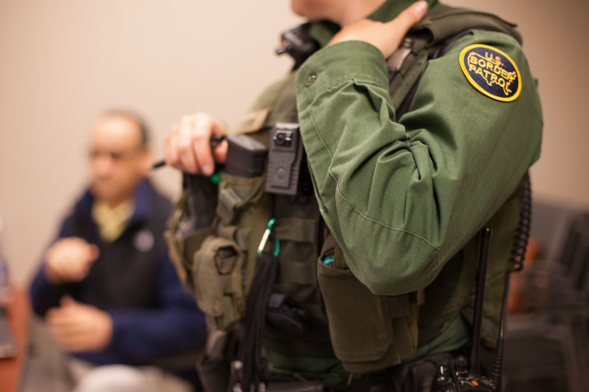 A photograph of CBP officer in an office room.