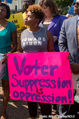 Advocate with sign voter suppression is oppression