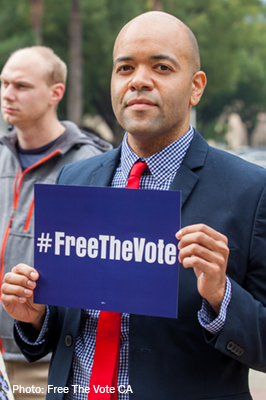 Individual holding #FreeTheVote sign