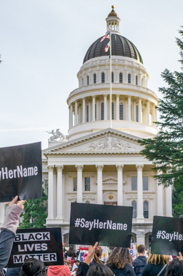 Advocates with signs at Capitol