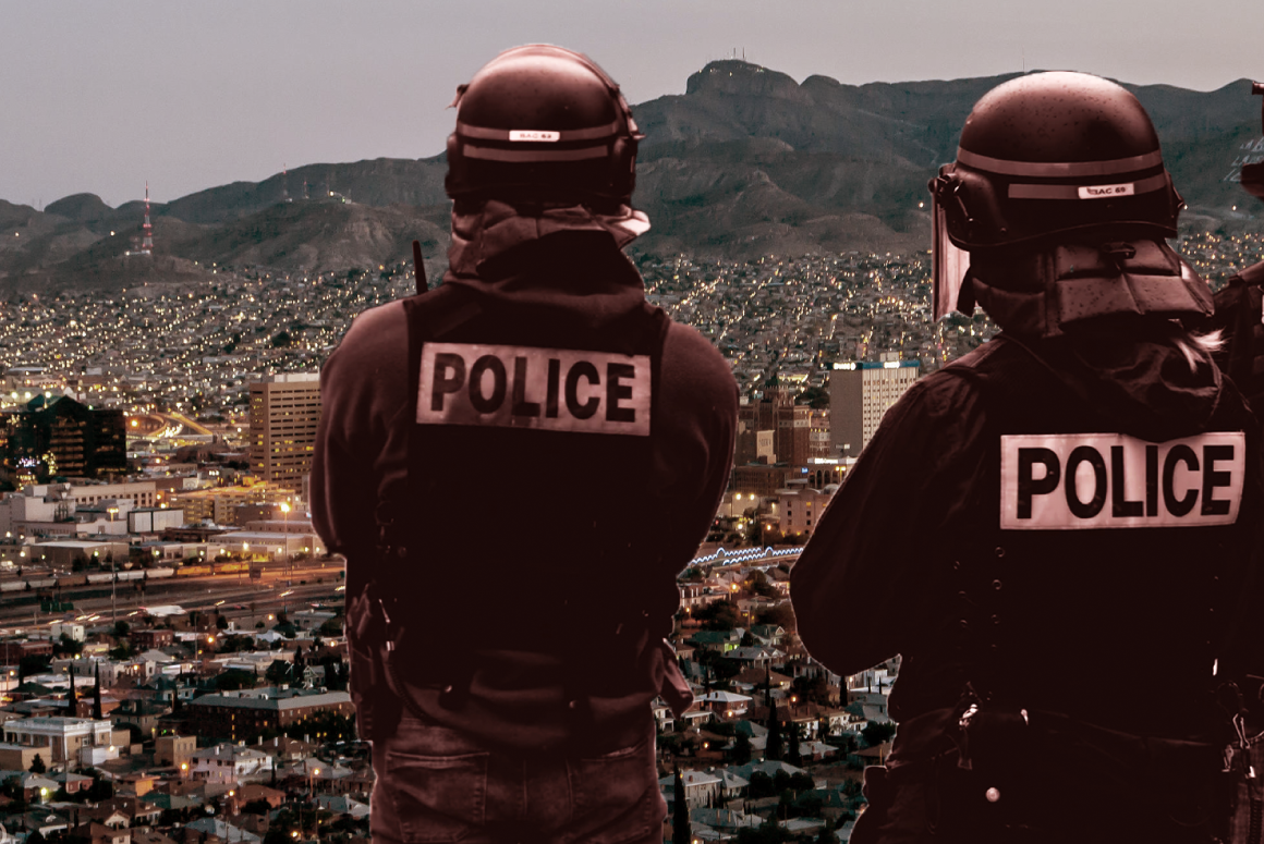 Police agents in the foreground of a photograph of El Paso