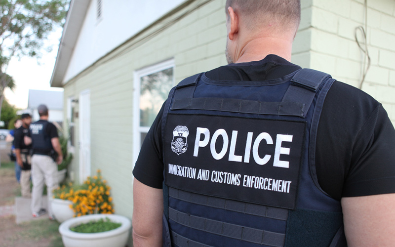ICE officers at a person's home