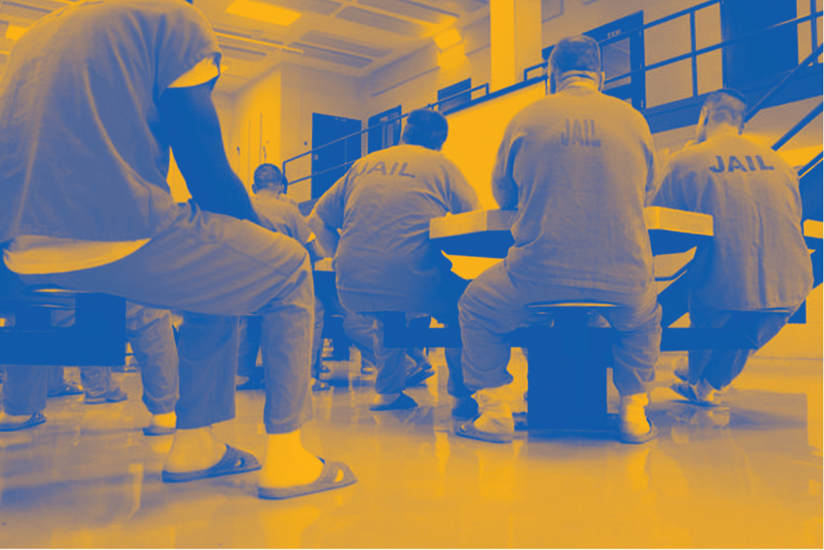 Inmates gather in a Texas carceral facilities with a dual tone yellow and blue treatment