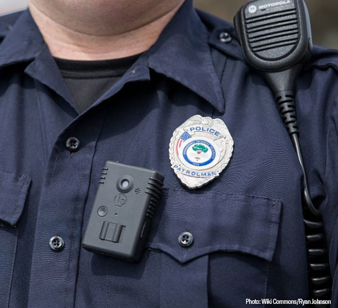Photo of police officer with body camera