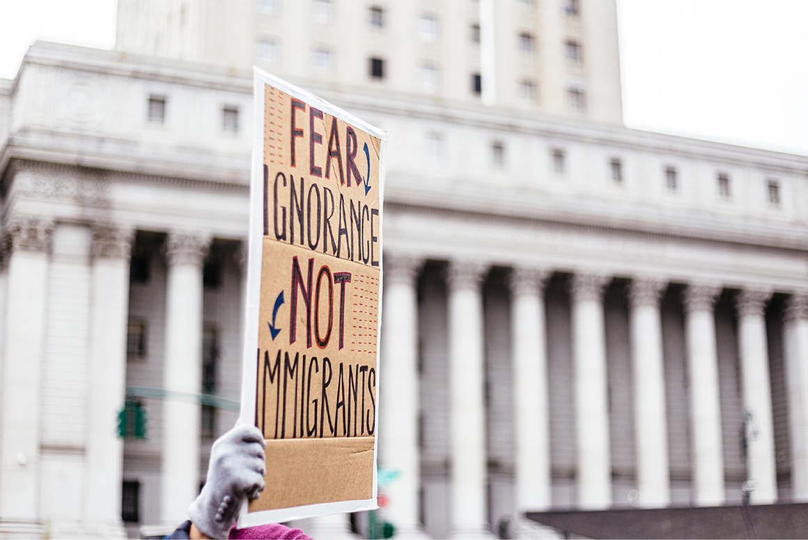 Immigration protest poster in front of courthouse