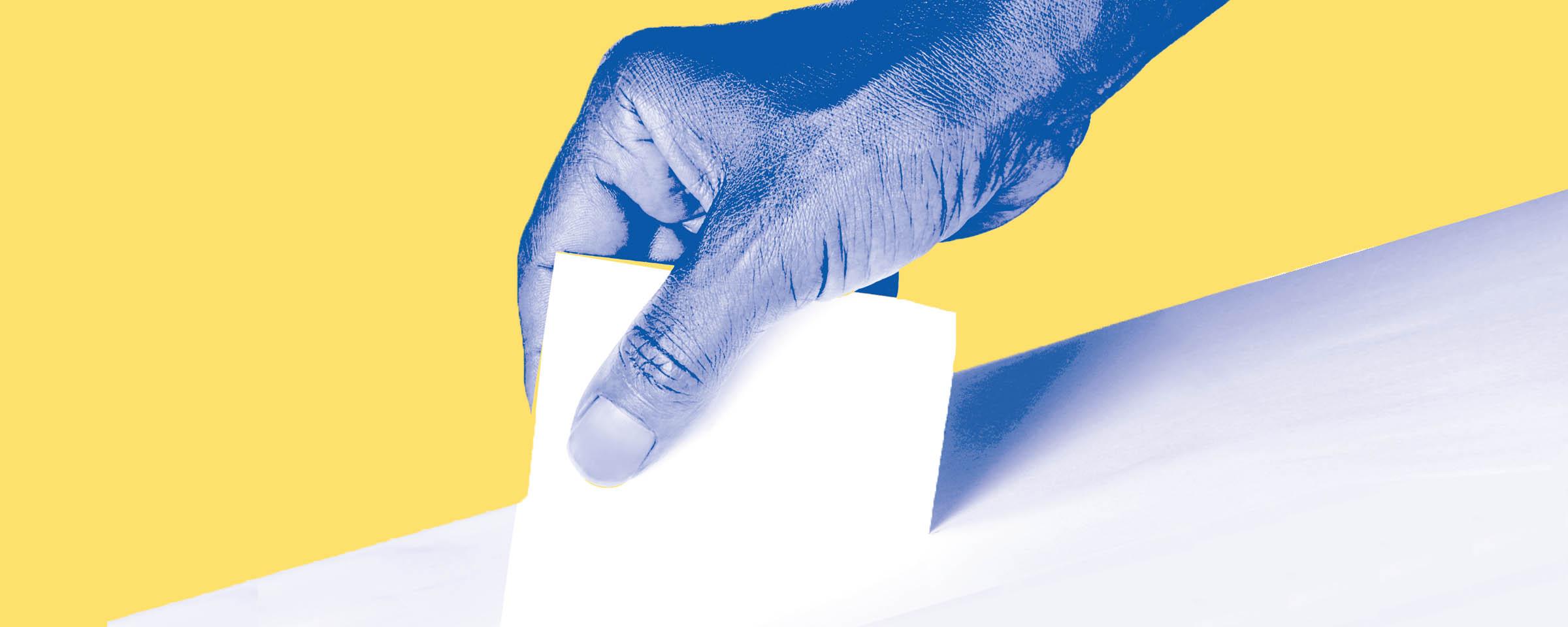 Person slipping their vote into a ballot box