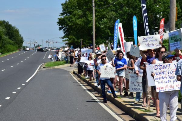Long crowd protesting the 287(g) program down a long main street in Frederick County, MD