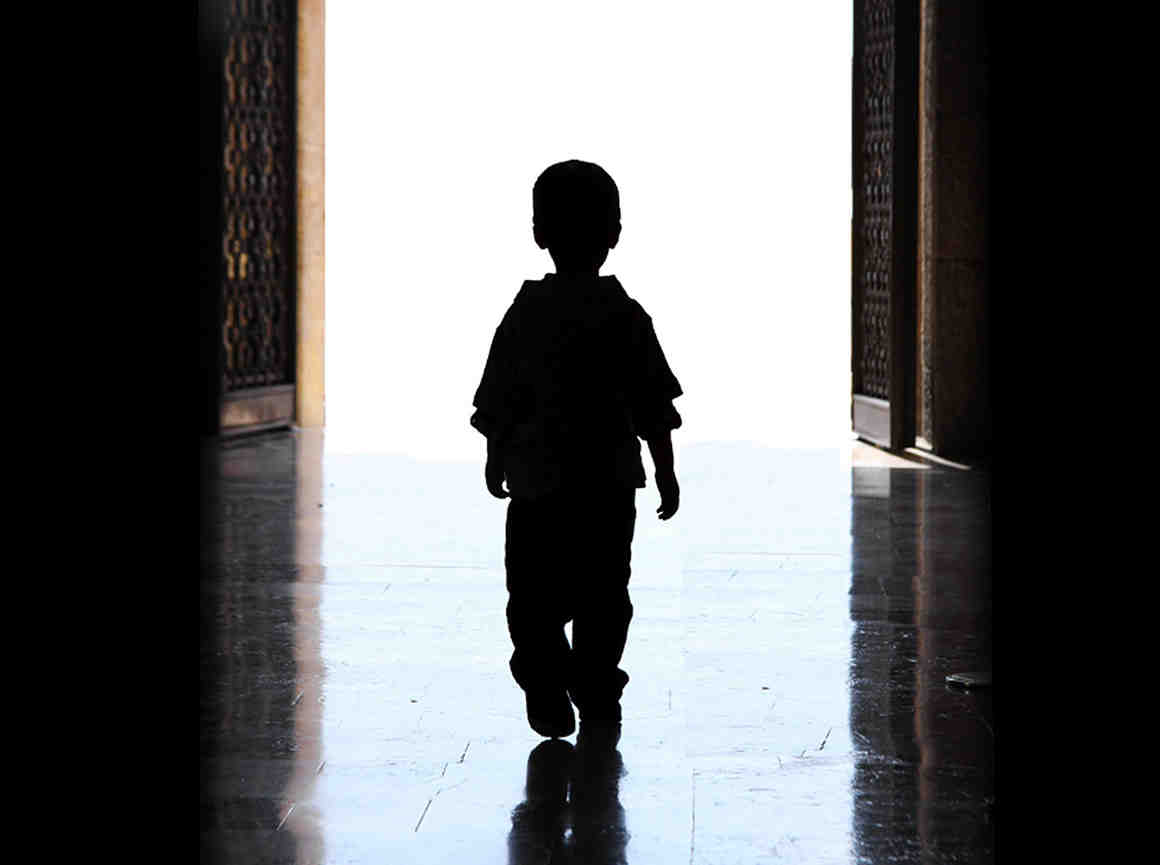Child walking in doorway